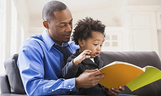 Father-and-son-reading-on-010